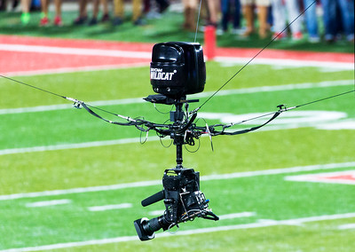 ESPN's flying SkyCam whizzes back and forth across the field.