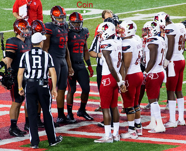 The ritual Coin Toss.  It determines that the Cardinals will receive first...