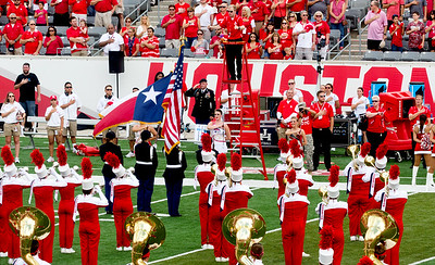 The National Anthem (which can hardly be heard on the North side of the Stadium.)