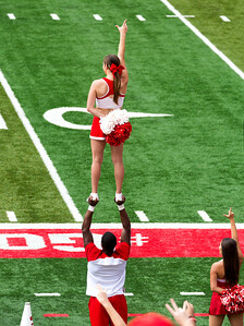 We sit behind the Lamar cheerleaders.