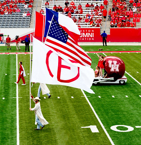 The Band is led in by the flags and helmet cart.