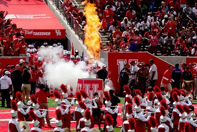 ... and here they come, led by Coach Herman.