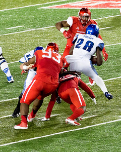 Memphis' Dorceus runs for some of his 124 yards in the game.