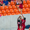 The UH cheerleaders rally the thin ranks of UH supporters.