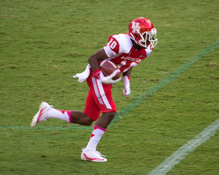 Wide receiver Ayers runs the ball.