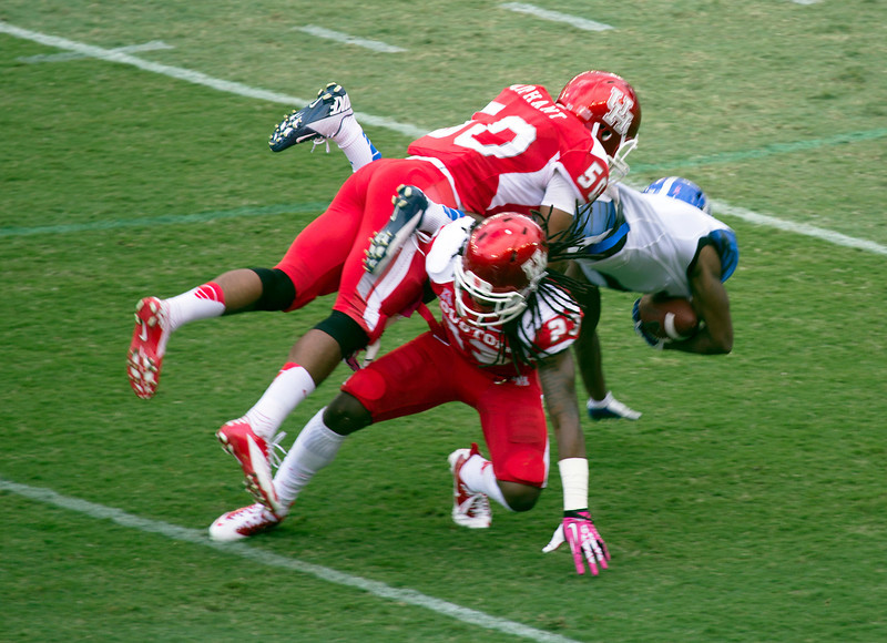 A Memphis receiver is tackled by Oliphant and Stewart