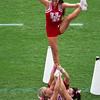 A cheerleader held high