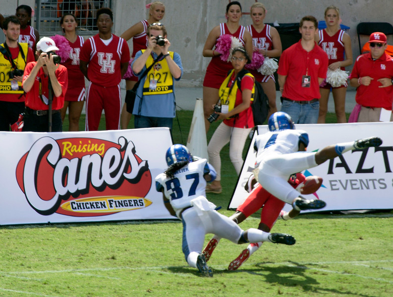 UH player being tackled by Memphis provides a photo-op.