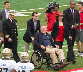 Pres. George H. W. Bush arrives to toss the coin.