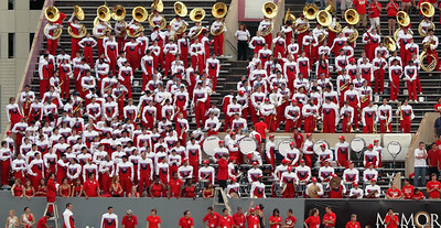 The UH marching band in the stands