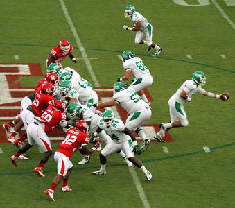 North Texas quarterback Thompson hands the ball off