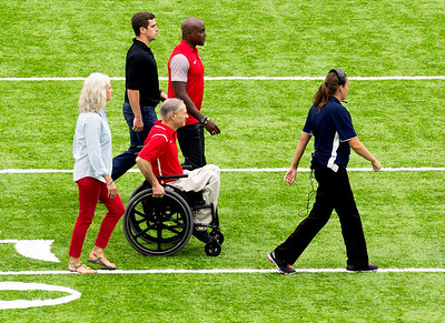 Governor Greg Abbott arrives for the coin toss.