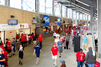 The Fans -- red for UH, blue for Rice -- move through the gallery.