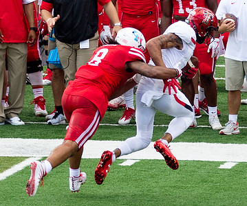 Willies is tackled by Eqbule after gaining 11 yards.