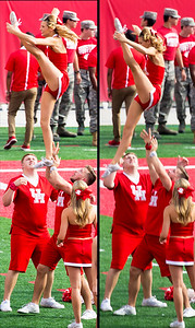 A UH cheerleader at the other end of the field practices her dismount.