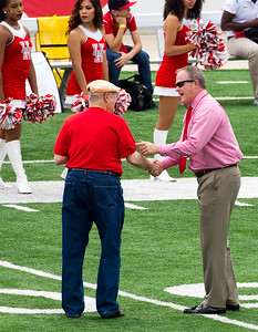 English Prof., Irv Rothman is honored as Faculty Member of the Game and awarded a game ball.