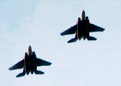 Suddenly ... WHOOSH ... we barely catch a fighter jet flyover to finish the Star Spangled Banner.