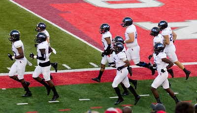 "The other end of the field: Here comes Tulsa's Golden Hurricane"" ..."