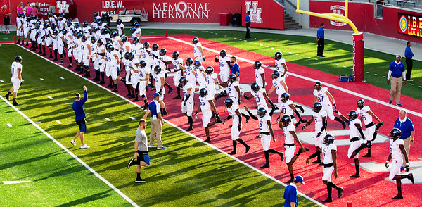The Tulsa team does its pregame stretching exercises ...