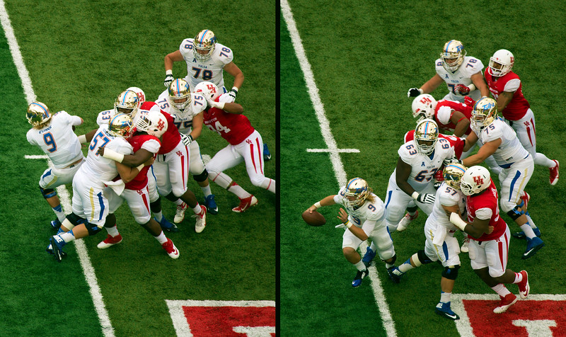 Tulsa quarterback Evans wiggles out of his collapsing pocket.