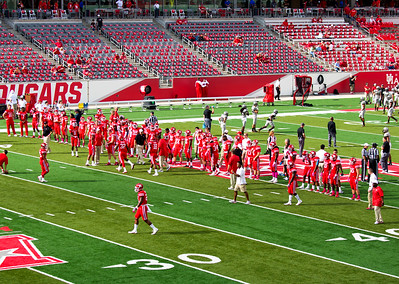 The UH Cougars line up as the finish their warmups.