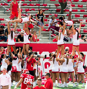 At the other end of TDECU, our cheerleader practice a complex stack.