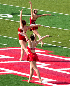 Three twirlers in formation