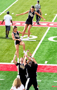 The UCF cheerleaders are right in front of us practicing their dismount.