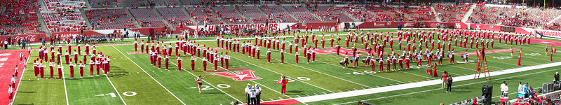 The band spells COUGARS (backward and upside down).