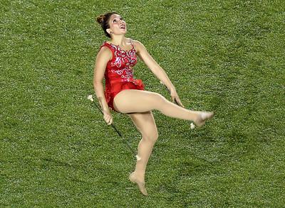 Cheerleader dancing, twirling.