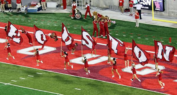 ... and the cheerleaders run their flags again.