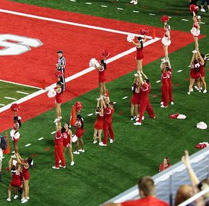 Cheerleaders two tiers deep.