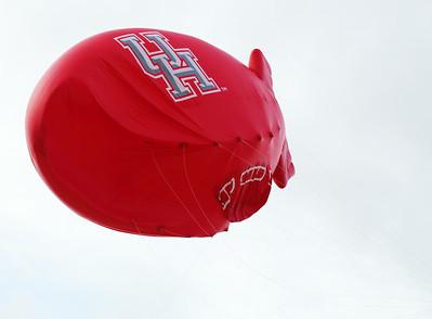 A big celebratory balloon floats over us.