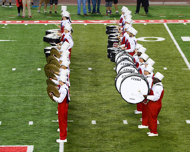 The UH Band's percussion leads the way onto the field.
