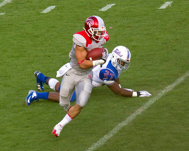 UH runner eludes a tackle