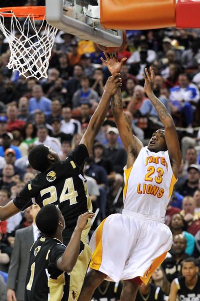 2010 Boys Basketball Tournament - Houston Yates (white) vs. Lewisville The Colony (black).  Houston Yates won 106-76.