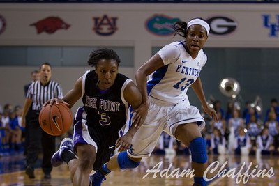 Sophomore guard, Bria Goss (right), guarding against senior guard, Erin Reynolds (right), during the second half of the UK vs. High Point basketball game at Memorial Coliseum on Saturday, Nov. 17, 2012. Photo by Adam Chaffins | Staff