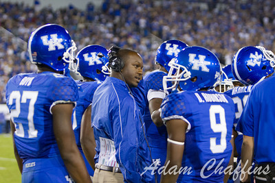 UK Studen Assistant Coach Glen Holt and his players during a timeout in the first half of the UK vs. Kent State football game at Commonwealth Stadium, Photo by Adam Chaffins