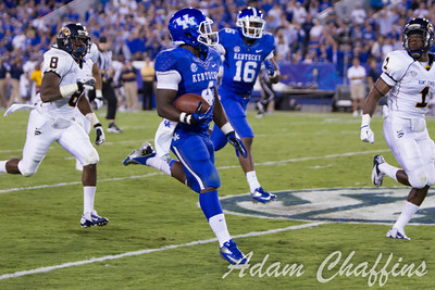 Raymond Sanders III, a junior Tail Back running wih the ball during the first half of the UK vs. Kent State football game at Commonwealth Stadium, Photo by Adam Chaffins