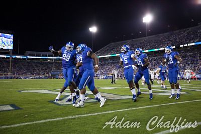 UK players celebrating after a touchdown during the second half of the UK vs. Kent State football game at Commonwealth Stadium, Photo by Adam Chaffins