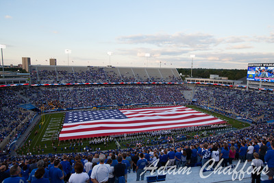Displaying the United States flag before the UK vs. Kent State football game at Commonwealth Stadium, Photo by Adam Chaffins