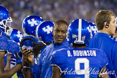 UK Student Assistant Coach Glen Holt and his players during a timeout in the first half of the UK vs. Kent State football game at Commonwealth Stadium, Photo by Adam Chaffins