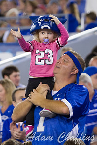A father and daughter celebrating a touchdown during the first half of the UK vs. Kent State football game at Commonwealth Stadium, Photo by Adam Chaffins