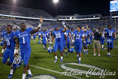 UK football players at the close of the UK vs. Kent State football game at Commonwealth Stadium after a big win, Photo by Adam Chaffins