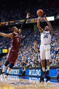 Senior guard, Julius Mays, shooting a three point shot with a block attempt from sophomore guard, Joey Ptasinski during the first half of the UK vs. Lafayette basketball game at Rupp Arena  on Friday, Nov. 16, 2012. Photo by Adam Chaffins | Staff