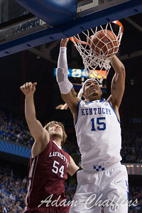 Freshman forward, Willie Cauley-Stein, dunking over freshman center, Nathaniel Musters, during the first half of the UK vs. Lafayette basketball game at Rupp Arena  on Friday, Nov. 16, 2012. Photo by Adam Chaffins | Staff