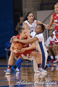 Marist senior guard Kristine Best (left) and UK senior guard A'dia Mathies (right) fight for the ball during the second half of the UK vs. Marist basketball game at Memorial Coliseum on Sunday, Dec. 30, 2012. Photo by Adam Chaffins | Staff