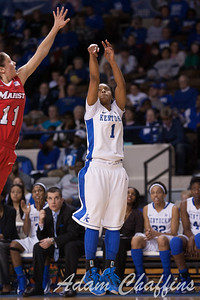 Marist junior guard (left)  Leanne Ockenden attempting to block UK senior guard A'dia Mathies' (right) three point shot during the second half of the UK vs. Marist basketball game at Memorial Coliseum on Sunday, Dec. 30, 2012. Photo by Adam Chaffins | Staff