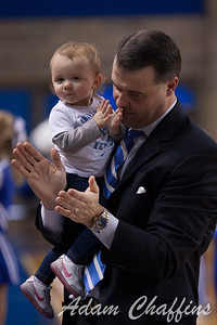 UK womens basketball head coach Matthew Mitchell with his daughter Saylor Rose at the conclusion of the UK vs. Marist basketball game at Memorial Coliseum on Sunday, Dec. 30, 2012. Photo by Adam Chaffins | Staff