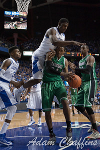 UK freshman forward Alex Poythress  plowing over Marshall junior forward Eljah Pittman during the second half of the UK vs. Marshall basketball game at Rupp Arena on Saturday Dec. 22, 2012. Photo by Adam Chaffins | Staff